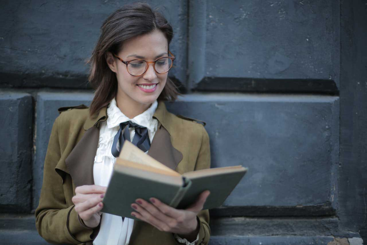 Smiling lady while holding a book